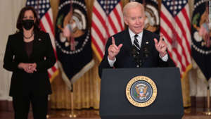 """U.S. President Joe Biden delivers remarks on his proposed """"Build Back Better"""" social spending bill as Vice President Kamala Harris (L) looks on in the East Room of the White House on October 28, 2021 in Washington, DC."""