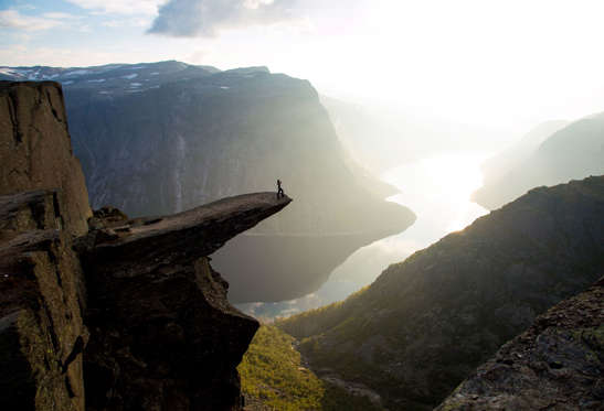 "Mandatory Credit: Photo by Solent News/REX Shutterstock (4217496e) A sightseer admires the view from the edge of Trolltunga People stand on the edge of a 700 metre-high cliff, Norway - Sep 2014 *Full story: http://www.rexfeatures.com/nanolink/pkfx A sightseer is seen doing yoga on the edge of a 700 metre-high cliff as she takes in the breathtaking views. Meanwhile, another group leap into the air while more careful visitors simply stand and admire the scenery. The photographs were taken by Christopher Baldry, 34, who was sitting on a rock nearby. The edge that his friends are standing on is a popular spot for photographers, called Trolltunga - which means 'Troll's Tongue.' Christopher took the shots whilst hiking on a cliff with friends in Norway, just a couple of hours away from his home. He said: ""We got there at around 6.30pm and went straight out to get some shots before setting up camp. ""There can be quite a lot of people up there, but by spending the night we were one group of people among maybe eight other groups. ""It's about 700 metres above the lake below. The view is amazing""."