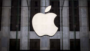 An Apple logo hangs above the entrance to the Apple store on Fifth Avenue in New York.