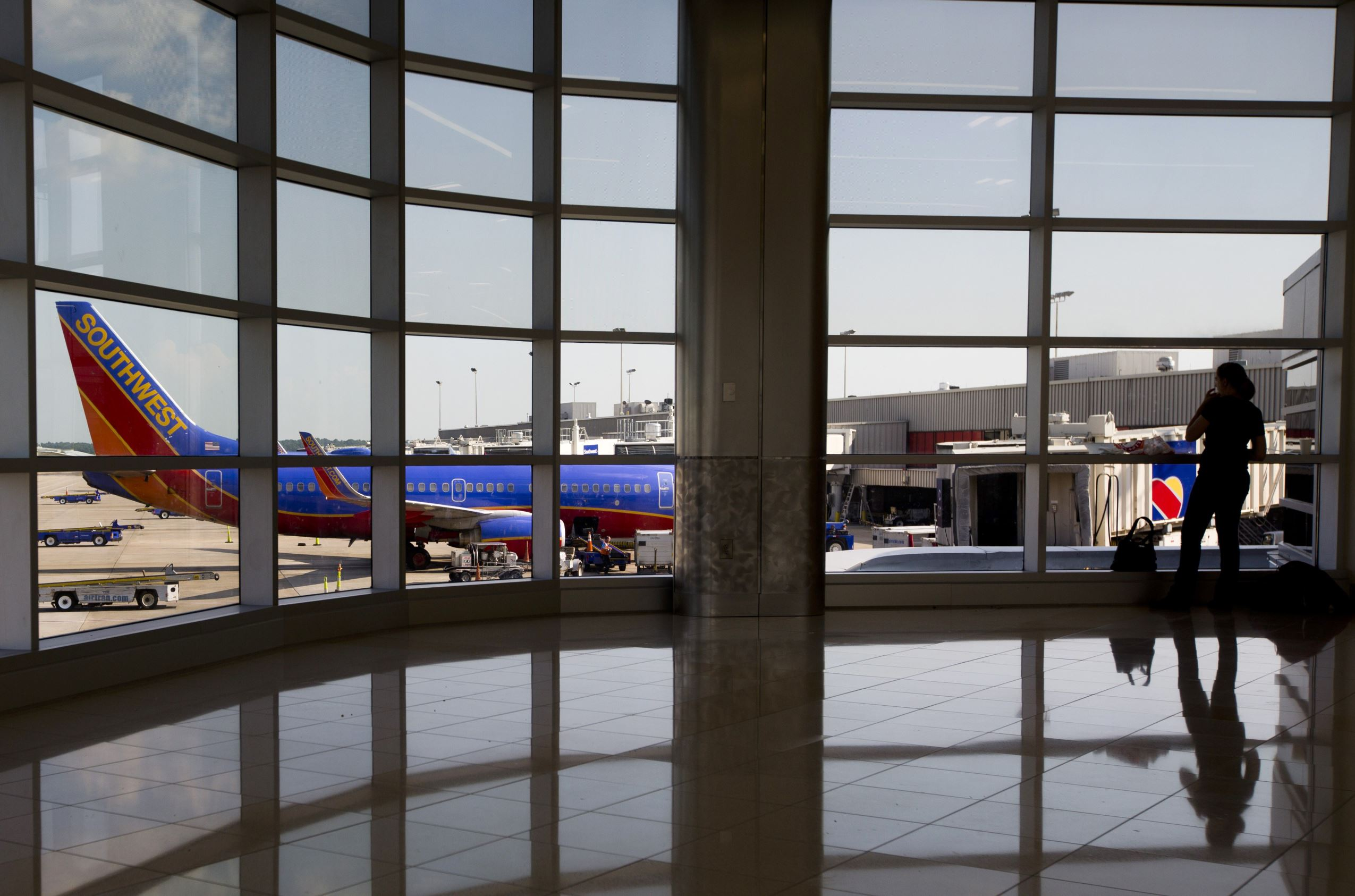 A passenger looks on near a Southwest Airlines plane at Hartsfield-Jackson Atlanta International Airport.