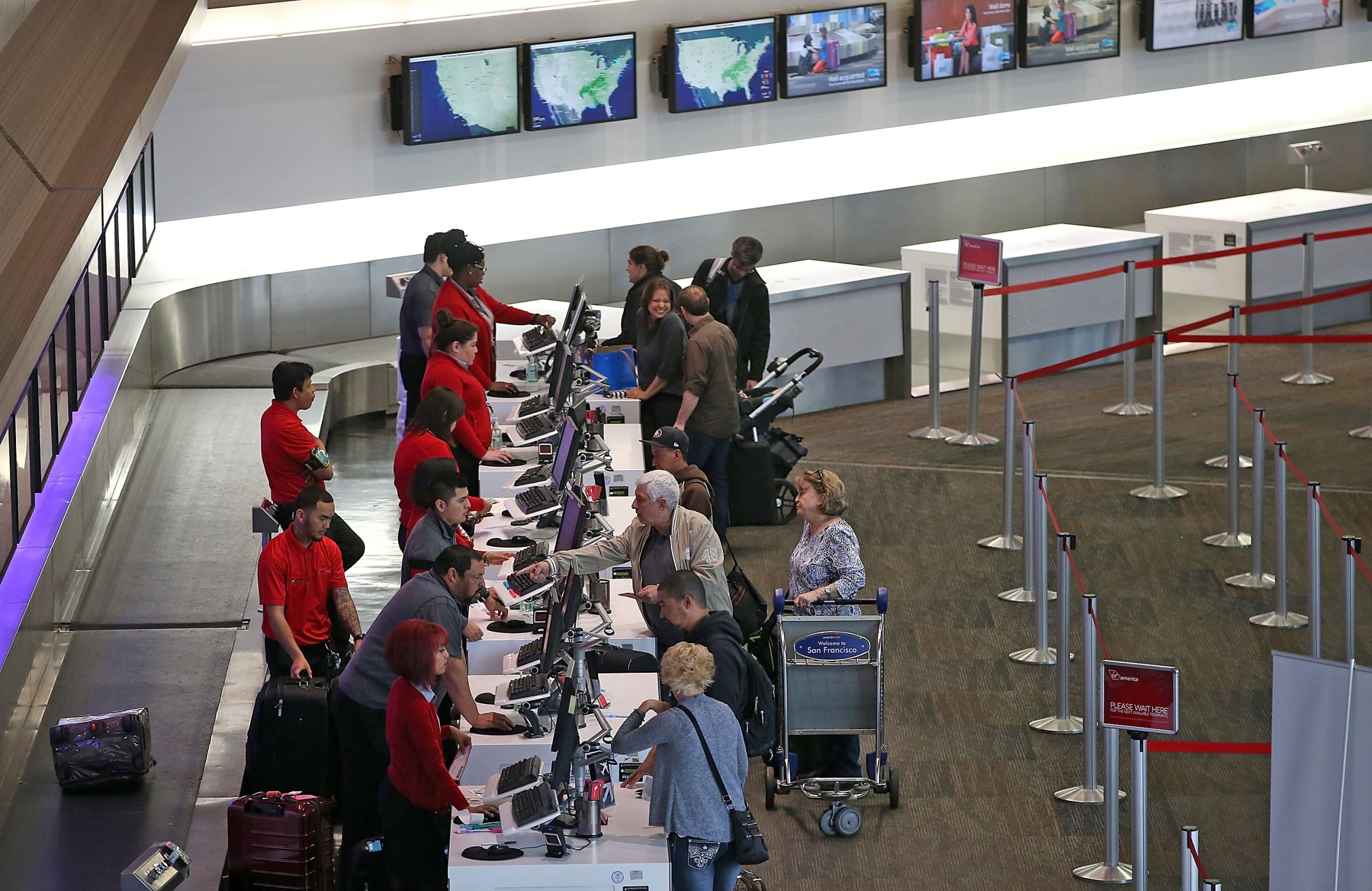 SAN FRANCISCO, CA - MARCH 13: Passengers check in for Virgin America flights inside terminal two at San Francisco International Airport on March 13, 2015 in San Francisco, California. According to a passenger survery conducted by SkyTrax, San Francisco International Airport (SFO) was been named the best airport in North America for customer service. SkyTrax collected over 13 million questionnaires at 550 airports around the world. (Photo by Justin Sullivan/Getty Images)