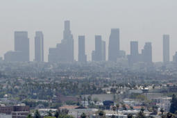 File photo of skyline of downtown Los Angeles seen through a layer of smog