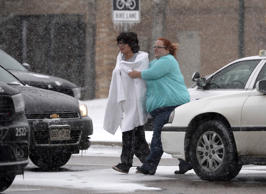 A person is escorted after reports of a shooting near a Planned Parenthood clini...