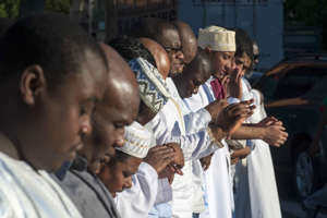 Worshippers take part in Eid Al-Adha prayers outside the Masjid At-Taqwa mosque in the Brooklyn borough of New York September 24, 2015.