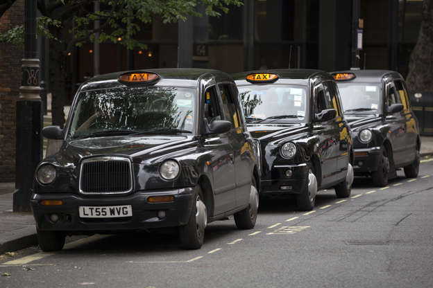 Slide 1 of 21: LONDON, ENGLAND - JUNE 02: Taxis wait on a rank in Westminster on June 2, 2014 in London, England. The controversial mobile application 'Uber', which allows users to hail private-hire cars from any location, is opposed by established taxi drivers and currently serves more than 100 cities in 37 countries. London's black cabs are seeking a High Court ruling on the claim that the Uber software is breaking the law by using an app as a taxi meter to determine rates. (Photo by Oli Scarff/Getty Images)