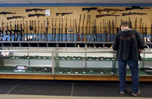 File photo of a customer looking over weapons for sale at a gun shop in Colorado in 2015.