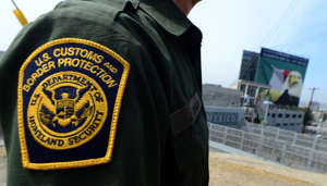 In this file photo, a U.S. Border Patrol agent stands near a crossing to Mexico at the San Ysidro port of entry along the U.S.-Mexico border near San Diego.