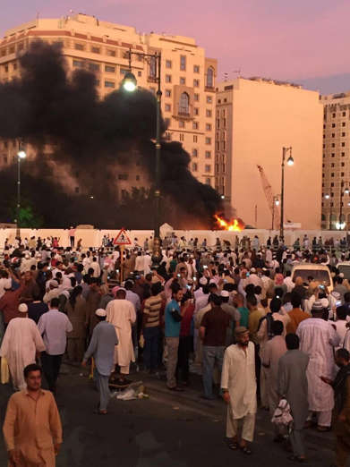 Muslim worshippers gather after a suicide bomber detonated a device near the security headquarters of the Prophet's Mosque in Medina, Saudi Arabia, July 4, 2016. REUTERS/Handout EDITORIAL USE ONLY. NO RESALES. NO ARCHIVE. TPX IMAGES OF THE DAY ...