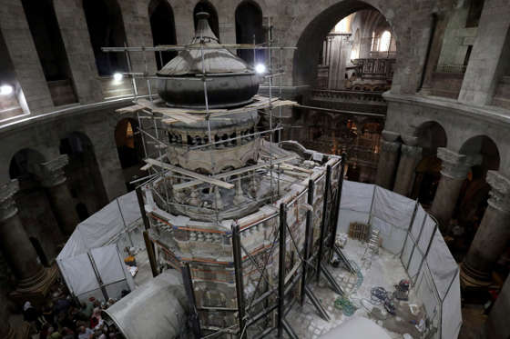 Greek preservation experts work to strengthen the Edicule surrounding the Tomb of Jesus, where his body is believed to have been laid, as part of conservation work done by the Greek team in Jerusalem on late on October 28, 2016. The experts from the National Technical University of Athens for cultural heritage preservation removed the marble slab stone that covered the original tomb since the last restoration of the edicule on 1810 by Greek architect Nikolaos Komnenos. The Church of the Holy Sepulchre in Jerusalems Old City is traditionally believed to be the site of Jesuss burial and attracts every year millions of pilgrims from all over the world. / AFP / GALI TIBBON (Photo credit should read GALI TIBBON/AFP/Getty Images)