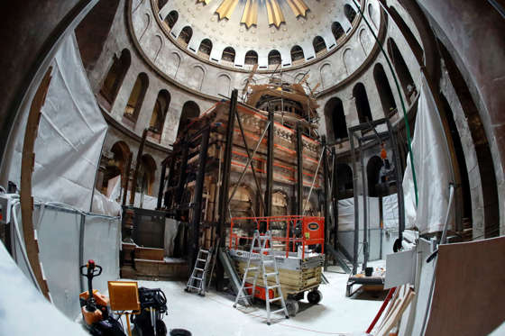 A picture taken on November 4, 2016 at the Church of the Holy Sepulchre in Jerusalems Old City shows the Edicule surrounding the Tomb of Jesus (where his body is believed to have been laid) being strengthened as part of the conservation work done by a Greek team of experts. The experts from the National Technical University of Athens for cultural heritage preservation removed the marble slab stone that covered the original tomb since the last restoration of the edicule on 1810 by Greek architect Nikolaos Komnenos. The Church of the Holy Sepulchre in Jerusalems Old City is traditionally believed to be the site of Jesuss burial and attracts every year millions of pilgrims from all over the world. / AFP / THOMAS COEX (Photo credit should read THOMAS COEX/AFP/Getty Images)