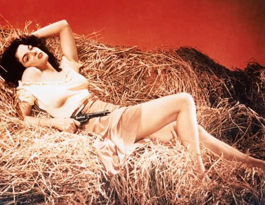 Διαφάνεια 6 από 45: Actress Jane Russell portrays Billy the Kid's girlfriend, Rio, in the 1943 motion picture The Outlaw. (Photo by Herbert Dorfman/Corbis via Getty Images)