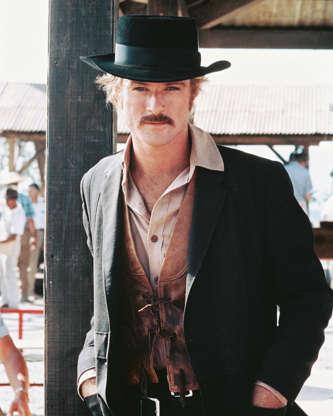Διαφάνεια 37 από 45: Robert Redford, US actor, in a Western costume, with a black cowboy hat and tan leather waistcoat, in a publicity portrait issued for the film, 'Butch Cassidy and the Sundance Kid', 1969. The Western, directed by George Roy Hill (1921-2002), starred Redf