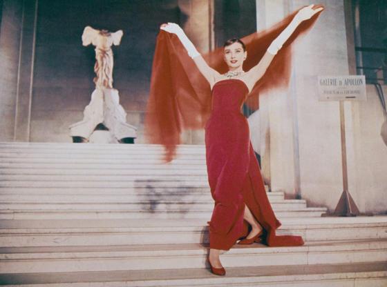 Διαφάνεια 23 από 45: Actress Audrey Hepburn (1929 - 1993) descends the Daru Staircase at the Louvre in Paris, in a scene from the film 'Funny Face', 1957. The ancient marble sculpture of the Winged Victory of Samothrace is visible at the top of the stairs. (Photo by Archive