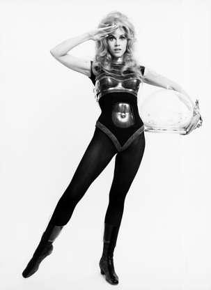 Διαφάνεια 35 από 45: Actress Jane Fonda wearing a form fitted costume including a bodysuit, tights, molded breast plate and clear plastic helmet in a publicity handout for the 1967 film Barbarella.