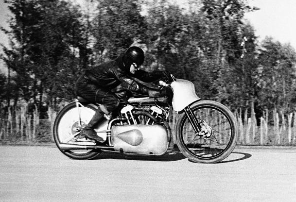 Slide 3 of 10: Eric Fernihough, the British racing motor cyclist, established two new world's speed records on the Gyon Road in Budapest, Hungary, on Nov. 9, 1936. On his 1,000 C.C. Brough Superior machine he averaged 164. 778 miles per hour as compared with the old record of 162.7 miles per hour. His other record was 80.964 miles per hour for the motor cycle-sidecar combination speed record. His first record was made with a flying start. Eric Fernihough at speed during his record breaking run at Budapest.