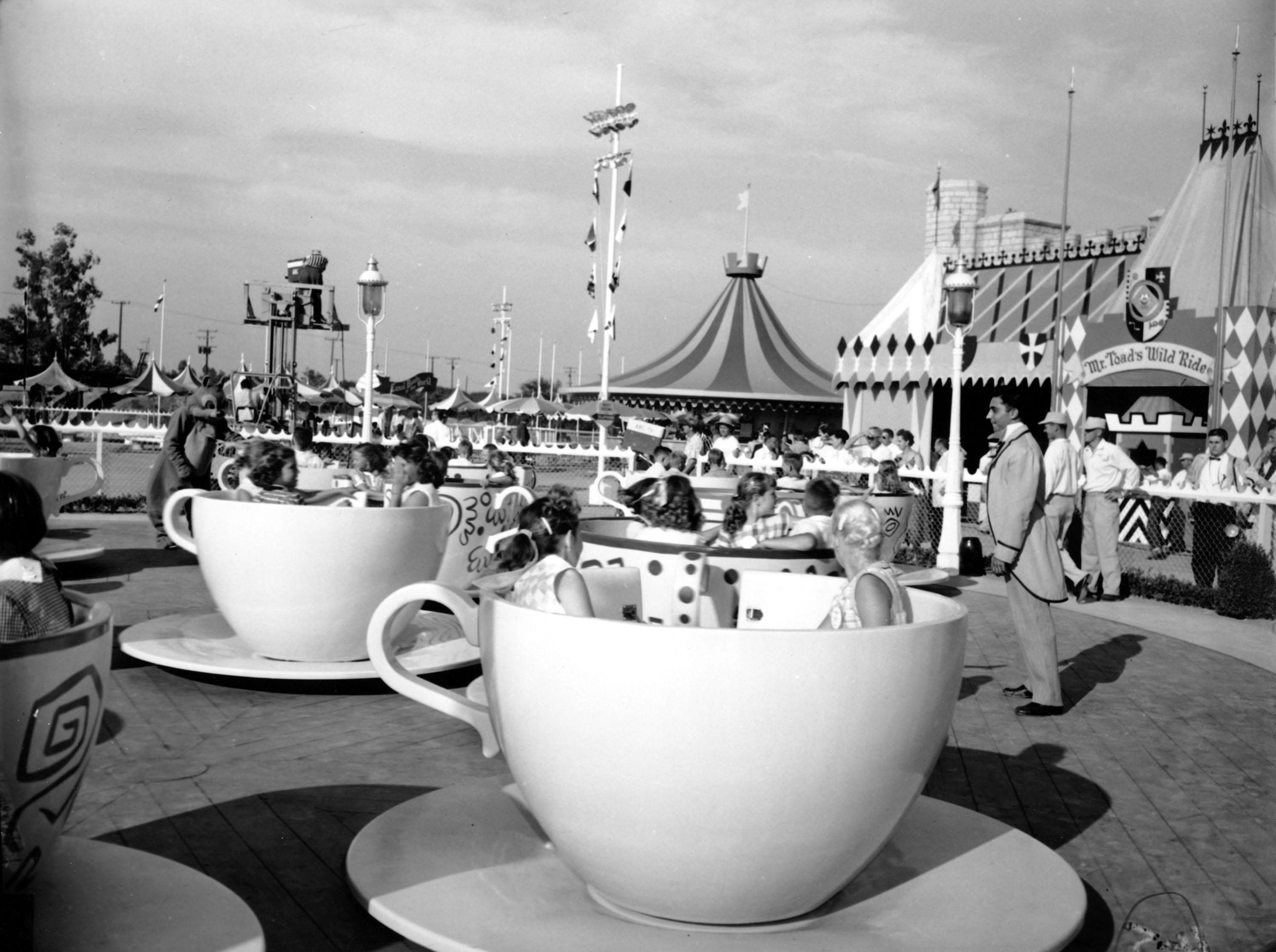 Slide 4 of 33: Children are enjoying the cup and saucer ride in Disneyland in Anaheim, Calif., on July 19, 1955. (AP Photo)