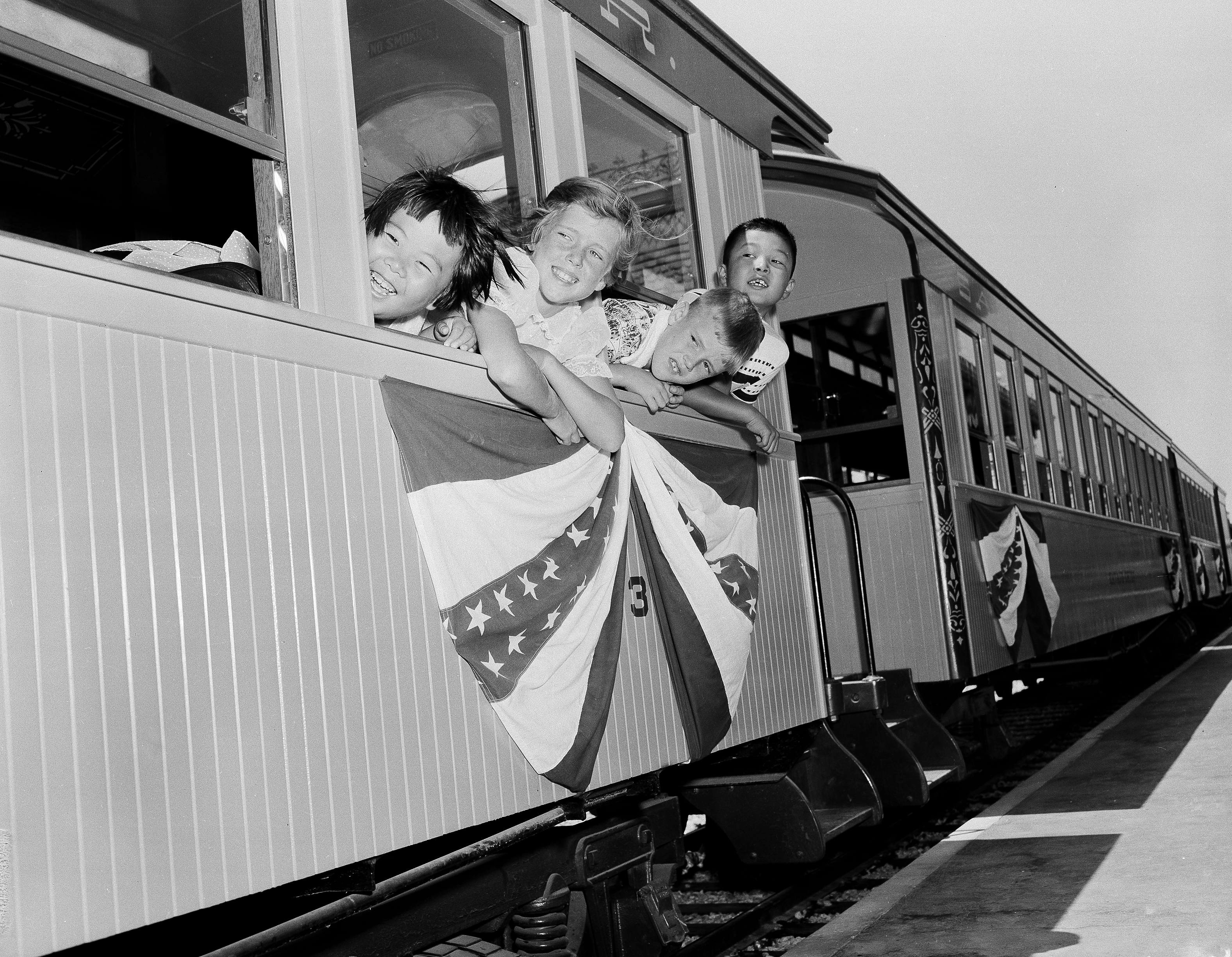 Slide 6 of 33: Children ride an old-time train around the 160 acre Disneyland, in Los Angeles, Calif., July 22, 1955. Disneyland opened in doors five days before on July 17. (AP Photo/Edward Kitch)