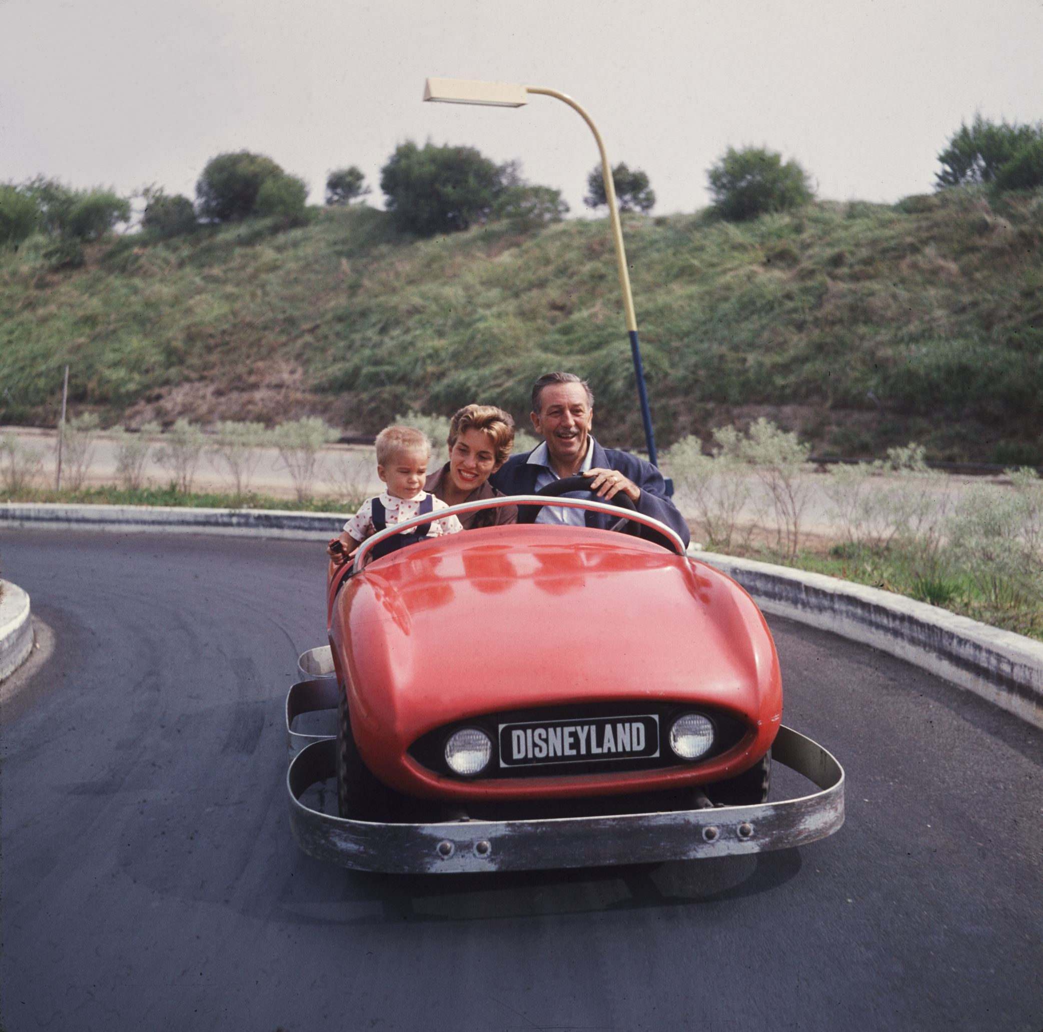 Slide 19 of 33: EXCLUSIVE Walt Disney (1901 - 1966) drives a red bumper car with his daughter and grandson as passengers at Disneyland theme park, Anaheim, California. (Photo by Gene Lester/Getty Images)
