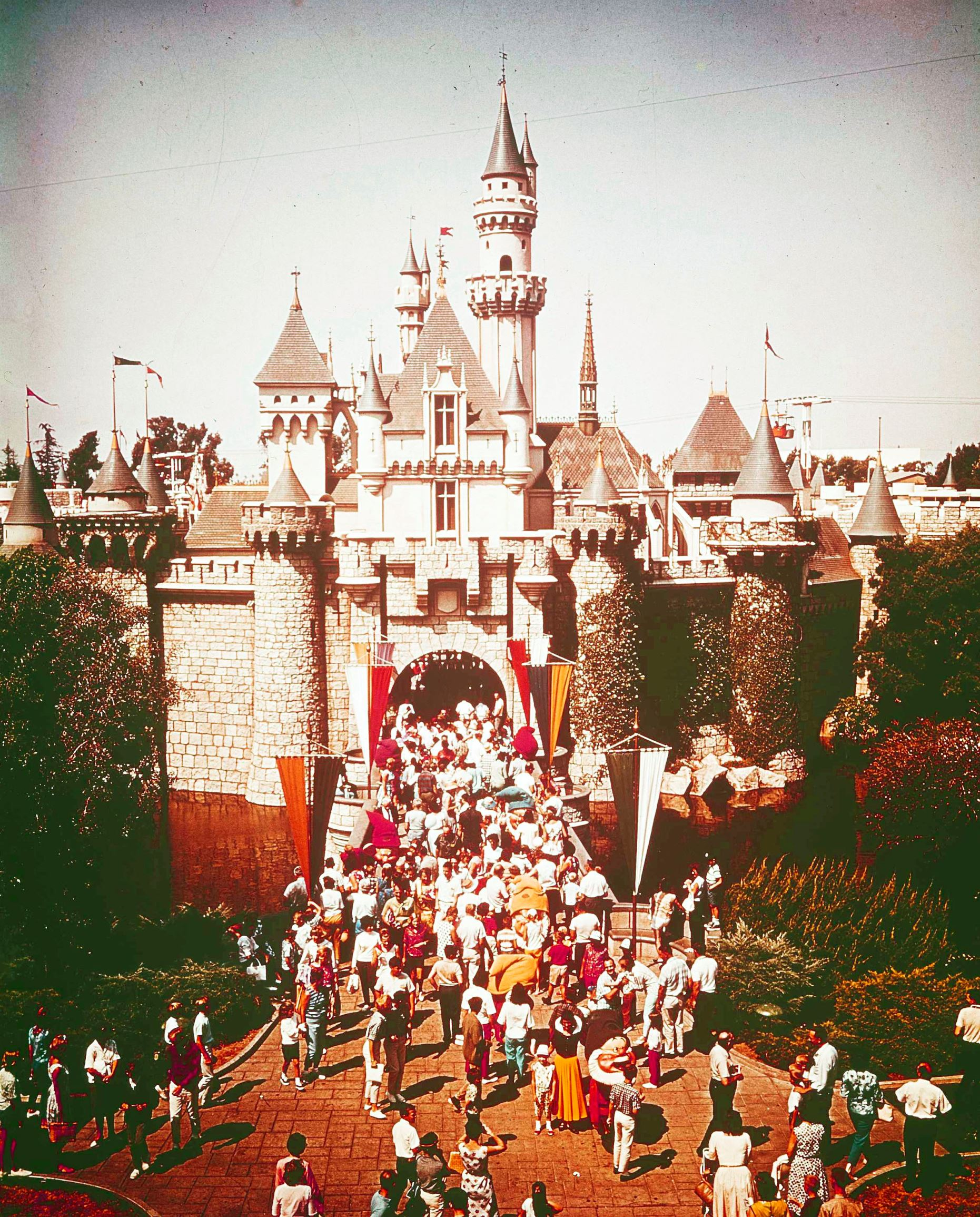 Slide 25 of 33: Visitors enter the Sleeping Beauty Castle of Fantasyland at Disneyland in Anaheim, Calif., Dec. 23, 1977. (AP Photo)