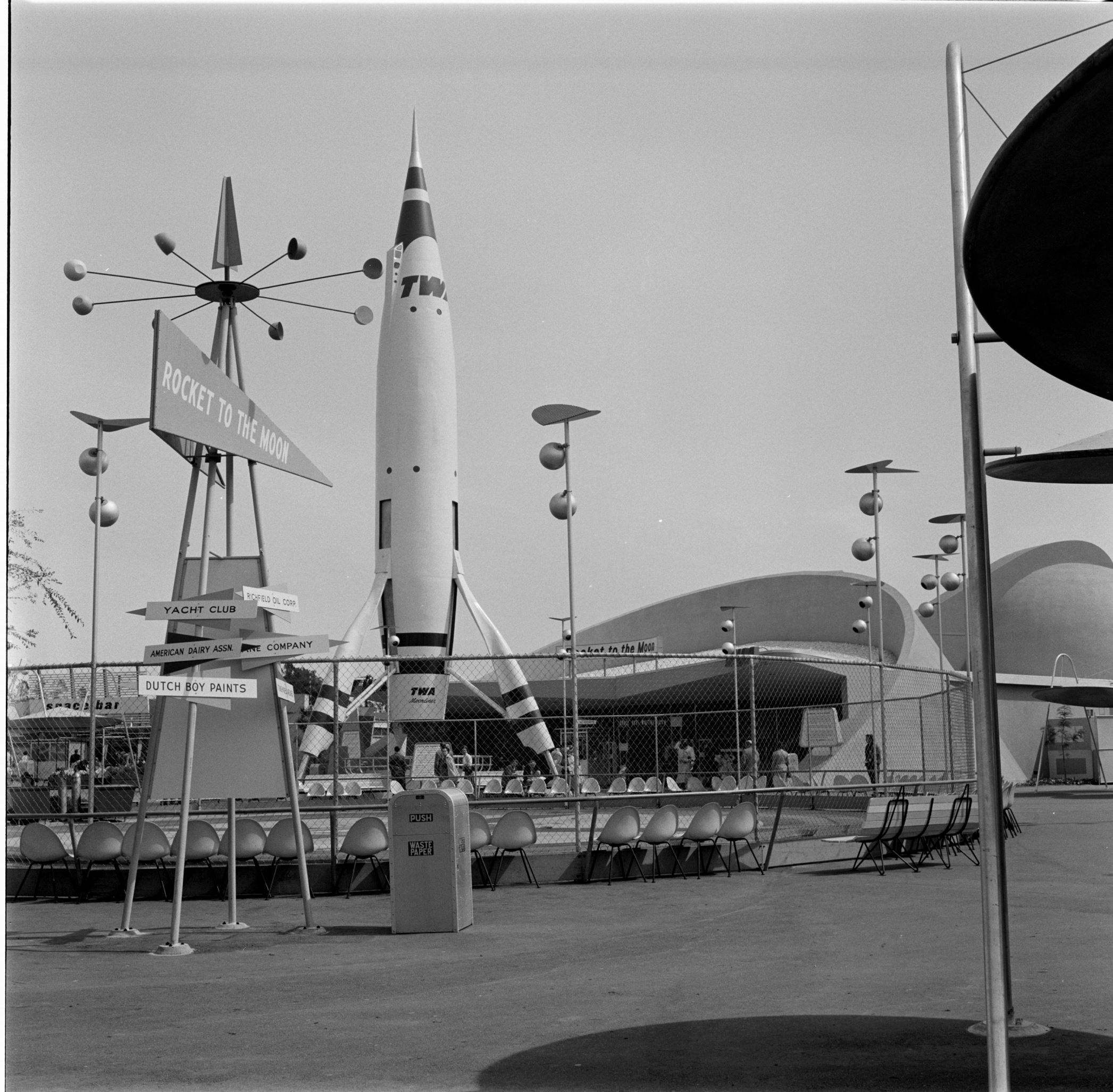 Slide 8 of 33: UNITED STATES - MARCH 19: Disneyland 1956. Tomorrowland represents the opportunities and abilities of the future, from earthbound science to extraterrestrial travel. Pictured is the red and white TWA-sponsored Rocket To The Moon standing 70 feet tall as the centerpiece of Tomorrowland. (Photo by Dick Day/The Enthusiast Network/Getty Images)