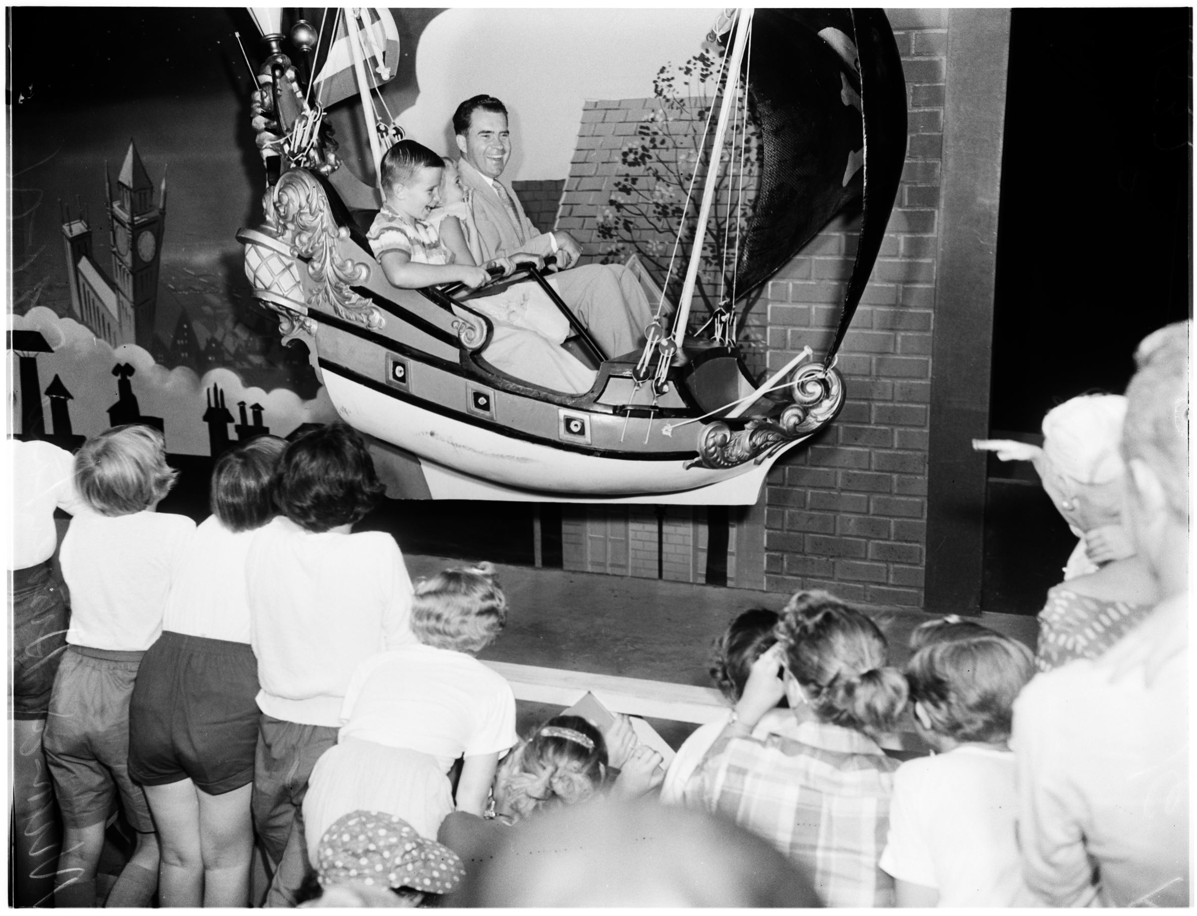 Slide 5 of 33: Donnie Nixon (nephew);Tricia, 9, and Vice President Nixon on Peter Pan ride EXM-N-11537-010~8 (Photo by USC Libraries/Corbis via Getty Images)