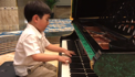 Child prodigy rehearses Chopin ahead of concert