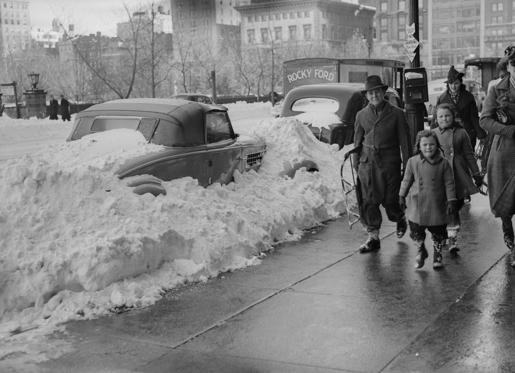 Slide 10 of 29: 2nd December 1938:  Cars covered with snow in 57th Street, New York, following  the city's first snowfall of the year.  (Photo by Horace Abrahams/Fox Photos/Getty Images)