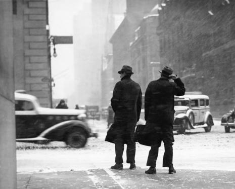 Slide 9 of 29: UNITED STATES - CIRCA 1950s:  Two men walking on city street in snow-storm.  (Photo by George Marks/Retrofile/Getty Images)