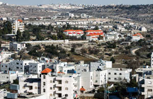 A picture taken on February 5, 2017 from the West Bank city of Hebron shows a general view of the nearby Israeli settlement of Givat Harsina.