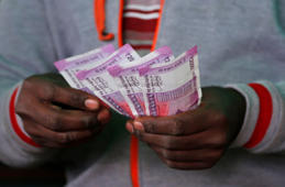 A trader counts new 2,000-rupee notes