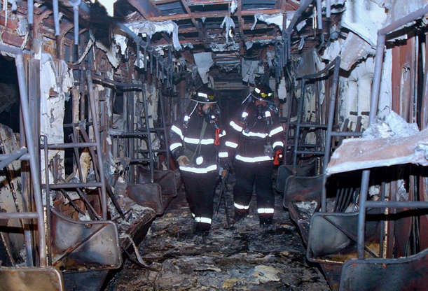 Slide 12 of 12: South Korean rescue workers inspect a subway train destroyed by a fire at a subway station February 18, 2003 in Daegu, 200 miles southeast of Seoul, South Korea. About 120 people were killed and at least 135 injured after a man ignited a milk carton filled with flammable material on a subway train in S. Korea's third largest city, officials said. Police are interrogating a 56-year-old man who was seen carrying a milk carton into the subway car, but no motive has been found.