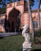 A sculpture of a lion stands before the Venetian-style gatehouse at Ca' d' Zan (Venetian pronunciation of House of John), John Ringling's Villa. Sarasota, Florida.