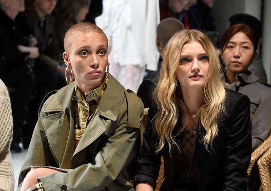 Slide 4 of 57: LONDON, ENGLAND - FEBRUARY 20:  Adwoa Aboah and Lily Donaldson wearing Burberry attend the Burberry February 2017 Show during London Fashion Week February 2017 at Makers House on February 20, 2017 in London, England.