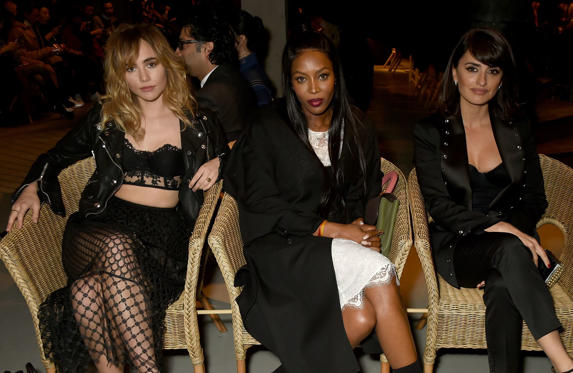 Slide 1 of 57: LONDON, ENGLAND - FEBRUARY 20:  (L-R) Suki Waterhouse, Naomi Campbell and Penelope Cruz wearing Burberry attend the Burberry February 2017 Show during London Fashion Week February 2017 at Makers House on February 20, 2017 in London, England.