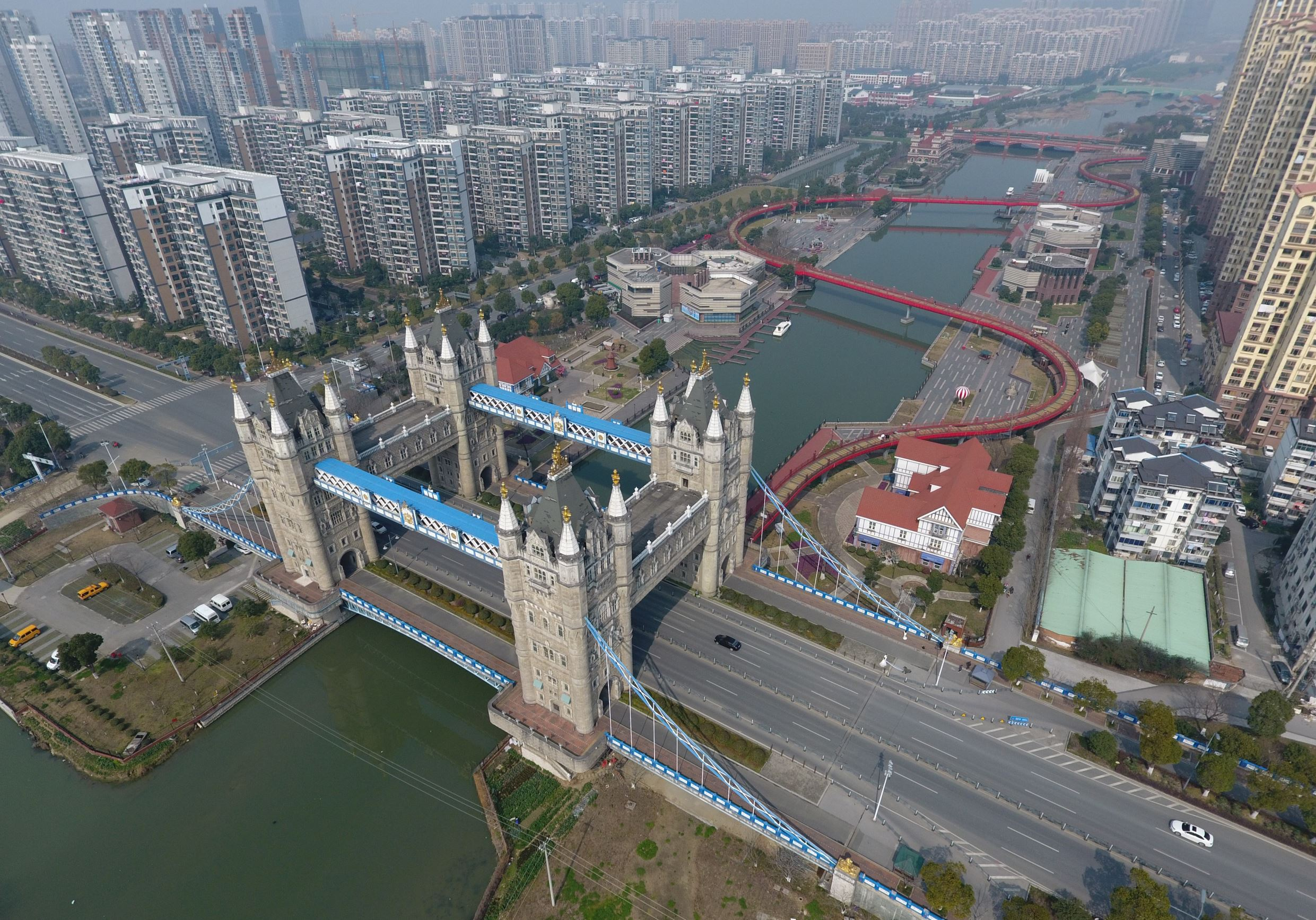 Slide 9 of 57: This photo taken on February 25, 2017 shows a bridge modeled on London's Tower Bridge, in Suzhou, in China's eastern Jiangsu province. The bridge features four 40 meter tall towers instead of two, but otherwise uses many design elements from the London o