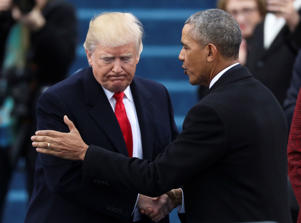 FILE PHOTO - President Barack Obama (R) greets President elect Donald Trump at inauguration ceremonies swearing in Donald Trump as the 45th president of the United States on the West front of the U.S. Capitol in Washington, U.S., January 20, 2017. REUTER