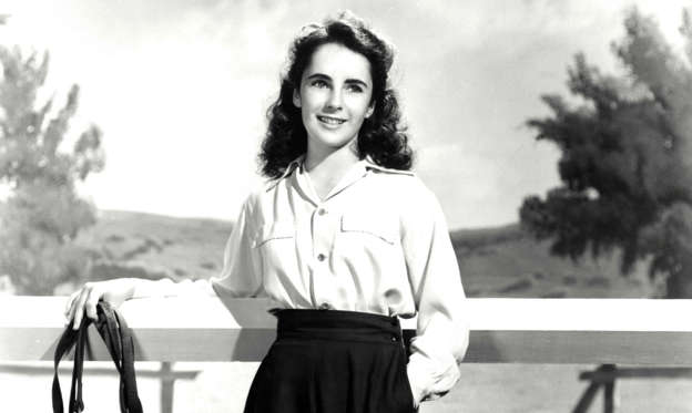 Slide 2 of 40: Elizabeth Taylor (12 years old) on the film set of ' National Velvet', directed by Clarence Brown in 1944.  (Photo by API/GAMMA/Gamma-Rapho via Getty Images)