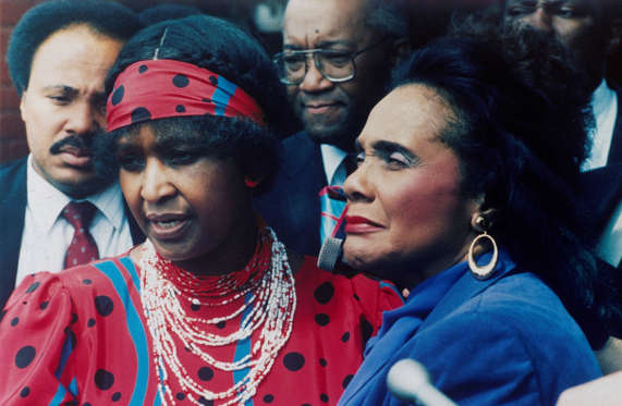Slide 19 of 26: In this Sept. 11, 1986, file photo, Winnie Mandela, left, wife of jailed African National Congress leader Nelson Mandela is joined by Coretta Scott King, widow of American civil rights leader Dr Martin Luther King Jr., in Soweto.