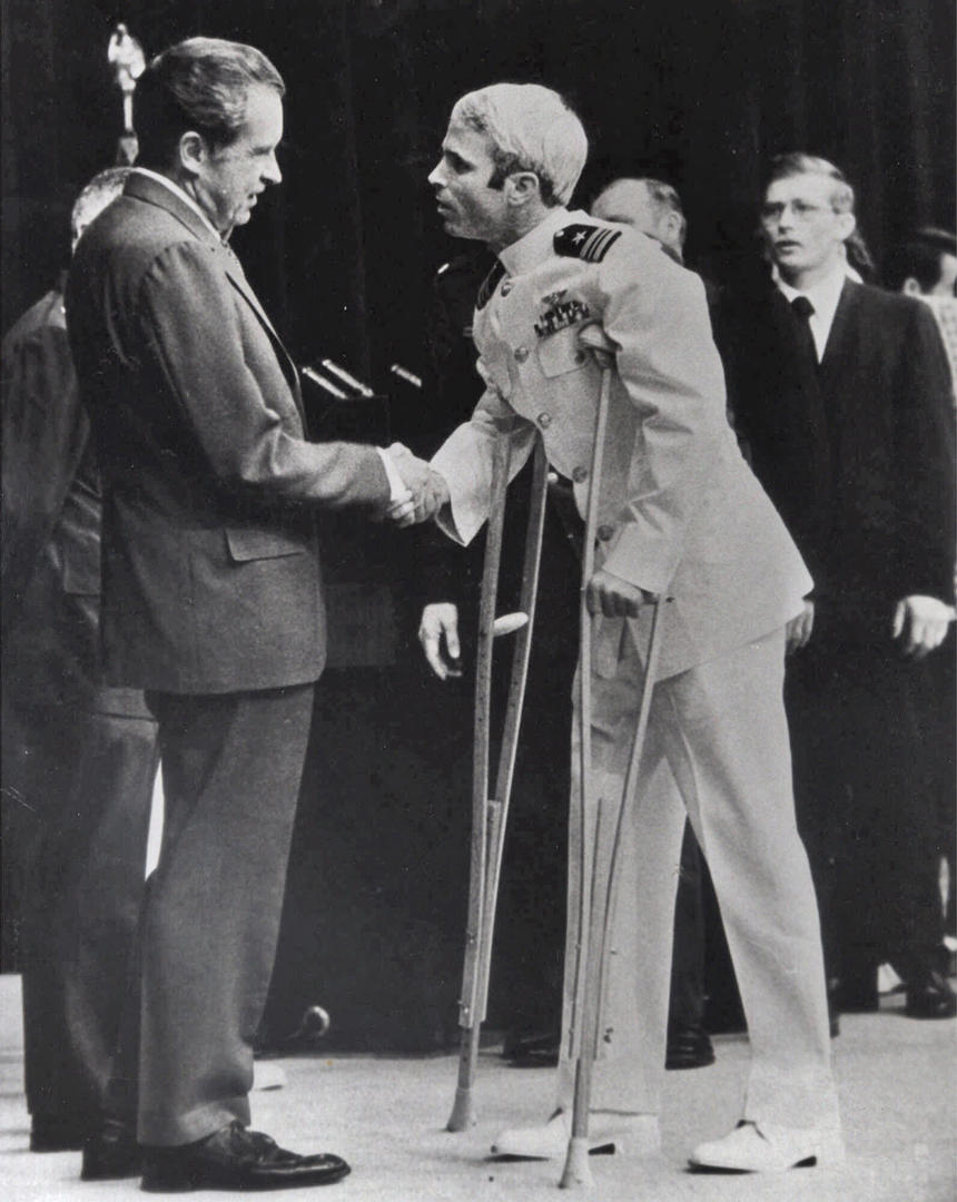 Slide 5 of 18: John McCain is greeted by President Richard Nixon, left, in Washington, Sept. 14, 1973. McCain spent more than five years in a Vietnamese prisoner of war camp before he was released in March of 1973.