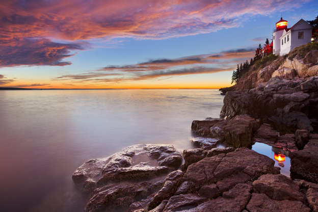 Слайд 8 из 17: The Bass Harbor Head Lighthouse in Acadia National Park, Maine, USA. Photographed at dusk after a spectacular sunset.