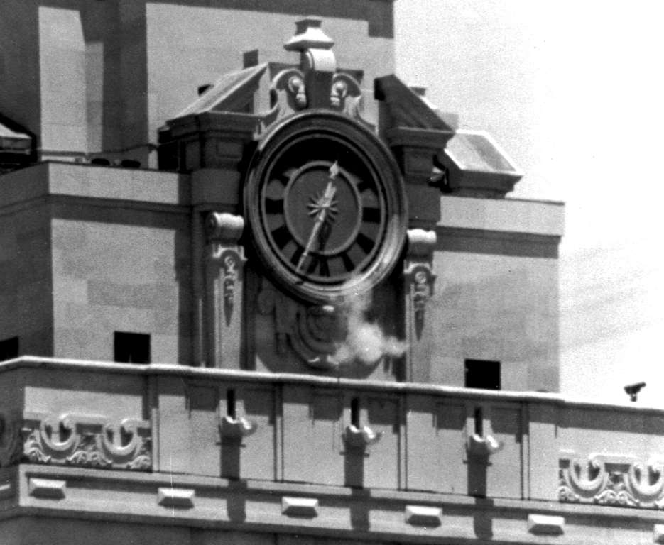 "Slide 10 of 15: FILE - In this Aug. 1, 1966, file photo, smoke rises from the sniper's gun as he fired from the tower of the University of Texas administration building in Austin, Texas, on crowds below. Police identified the slayer as Charles Whitman, a student at the university. The new documentary ""Tower"" about the shooting spree captures a sense of terror and confusion that was unprecedented then as it has become chilling commonplace today. (AP Photo/File)"