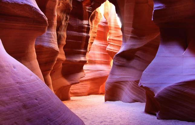 Διαφάνεια 30 από 37: This famous slot canyon in the Navajo Nation in Arizona is an enchanting series of narrow passageways that have eroded over time, creating flowing shapes in the rock. The canyon is also the subject of the most expensive photograph in the world, but if you want to capture your own version, you better get some pro tips...