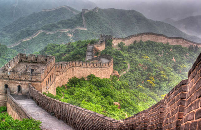 Διαφάνεια 2 από 37: The 2,000-year-old Great Wall of China stretches more than 13,000 miles from east to west. Built to protect the historical northern border of China, its architectural grandeur and historical significance are just some of the reasons it's worth seeing it. But if you're expecting to stroll down a deserted path that snakes through the countryside, you might want to think again…