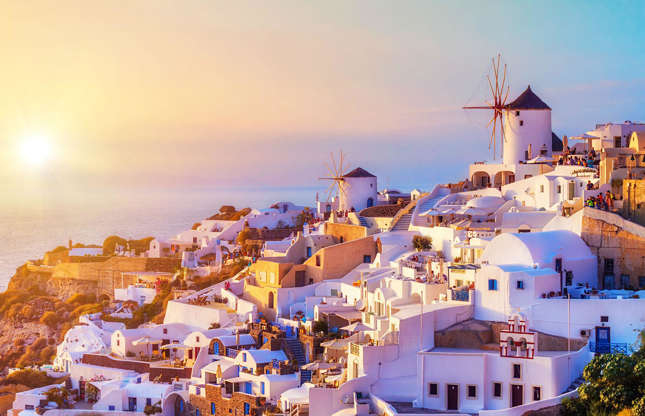 Διαφάνεια 12 από 37: This Greek island's terraced villages are a top spot for watching the romantic sunsets over the Aegean Sea. Santorini is on many travel bucket lists and visitors are often eager to capture the unmistakable windmills and blue-and-white houses perched on the cliffs. It's not as serene as it looks in the picture though…