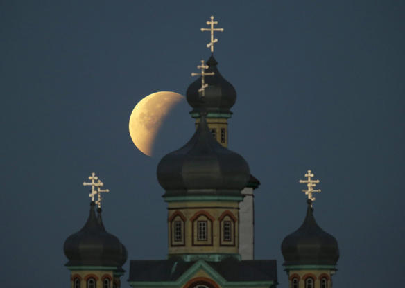 Slide 1 of 53: The Super Moon During a Lunar Eclipse in the Sky Above a Church in Turets Village Some 110 Km From Minsk Belarus 28 September 2015 the Combination of a Supermoon and Total Lunar Eclipse Last Occurred in 1982 and Will not Happen Again Until 2033 Belarus Turets