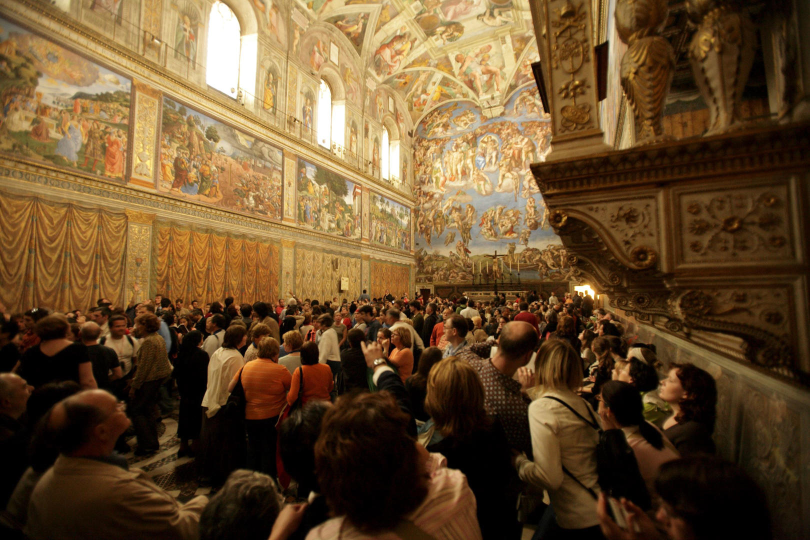 Slide 8 of 9: Crowd Touring the Sistine Chapel