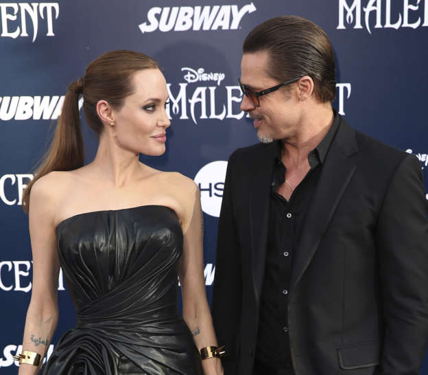 "In this May 28, 2014 file photo, Angelina Jolie and Brad Pitt arrive at the world premiere of ""Maleficent"" in Los Angeles."