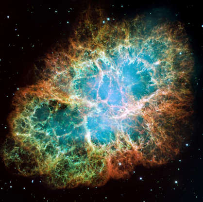 Slide 46 of 86: IN SPACE - DECEMBER 1: In this handout from NASA, the mosaic image, one of the largest ever taken by NASA's Hubble Space Telescope of the Crab Nebula, shows six-light-year-wide expanding remnant of a star's supernova explosion as released December 2, 2005. Japanese and Chinese astronomers witnessed this violent event nearly 1,000 years ago in 1054, together with, possibly, Native Americans. The orange filaments are the remains of the star and consist mostly of hydrogen. The rapidly spinning neutron star embedded in the center of the nebula is the dynamo powering the nebula's eerie interior bluish glow. The blue light comes from electrons whirling at nearly the speed of light around magnetic field lines from the neutron star. The neutron star, the crushed ultra-dense core of the exploded star, ejects twin beams of radiation that appear to pulse 30 times a second due to the neutron star's rotation. (Photo by NASA via Getty Images)