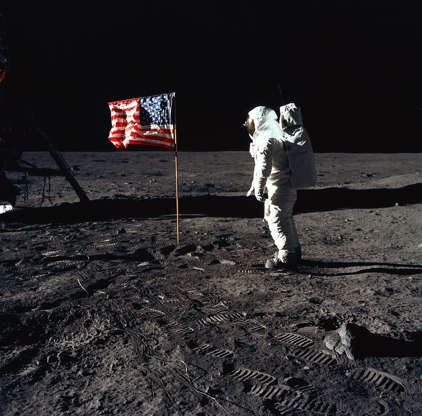 Slide 68 of 86: 376713 03: (FILE PHOTO) Astronaut Edwin E. Aldrin, Jr., the lunar module pilot of the first lunar landing mission, stands next to a United States flag July 20, 1969 during an Apollo 11 Extravehicular Activity (EVA) on the surface of the Moon. The 30th anniversary of Apollo's moon landing is celebrated July 20, 1999. (Photo by NASA/Newsmakers)