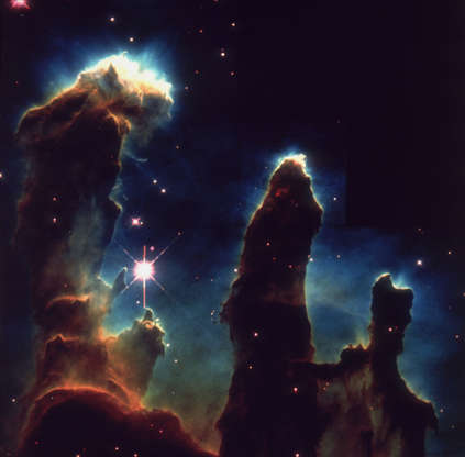 Slide 60 of 86: 1st April 1995: An image taken via Hubble telescope entitled Pillars of Creation, depicting gaseous pillars in M16, the Eagle Nebula. These columns of hydrogen and dust act as incubators for new stars. (Photo by Space Frontiers/Hulton Archive/Getty Images)